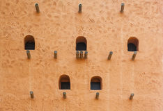 African adobe wall structure with beams and windows Royalty Free Stock Images
