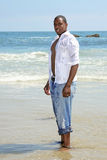 African Amercian Male Standing in the Ocean Surf Royalty Free Stock Photos