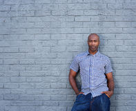 African america man standing against a gray wall Stock Image