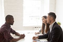African American advisor consulting millennial couple in office royalty free stock images
