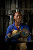 African American with angle grinder Stock Image