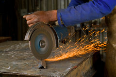 African American with angle grinder Royalty Free Stock Images