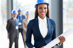African american architect. Beautiful african american architect holding blue print Stock Images