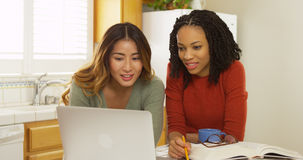 African American and Asian college students using laptop computer to study Royalty Free Stock Images