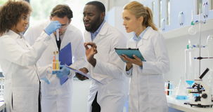 African American Assistant Woman Show Team Of Scientists Different Test Tubes, Team Of Researchers Making Notes stock footage