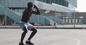 African American athlete man warm up running on the spot outside. Sport workout motivation healthy lifestyle sunny day stock video footage