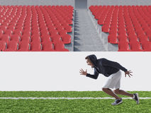 African American athlete running on soccer field. African American athlete is running on soccer field. Concept of being fit. 3d rendering. Mock up royalty free stock photo