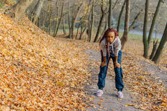 African american attractive girl after jogging in park. Autumn. African american attractive girl after jogging in park. Autumn Stock Photo
