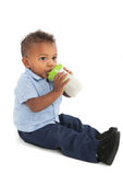 African American Baby Boy Drinking Milk with Bottle Royalty Free Stock Photo