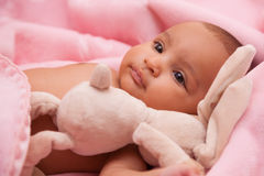 African american baby girl playing with a plush Royalty Free Stock Photos