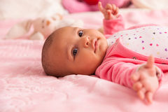 African american baby girl playing with a plush stock photography