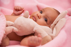 African american baby girl playing with a plush Royalty Free Stock Images