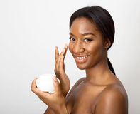 Beauty. African american beauty using face cream Royalty Free Stock Photo