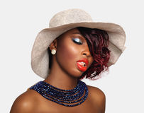 African american beauty woman. Wearing hat with blue beaded necklace Stock Photos