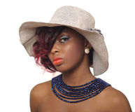 African american beauty woman. Wearing hat with blue beaded necklace Stock Photo