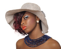 African american beauty woman. Wearing hat with blue beaded necklace Royalty Free Stock Image