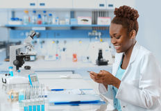 African-american biologist texting Stock Photography