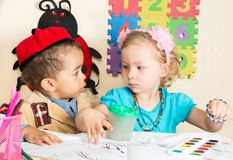 African American black boy and girl drawing with colorful pencils in preschool in kindergarten. African American black boy and girl drawing with colorful pencils stock photo