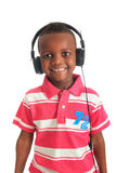 African american black child listening to music. Isolated metisse curly hair Royalty Free Stock Images