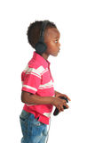 African american black child listening to music 3. African american black child listening to music isolated metisse curly hair Royalty Free Stock Images