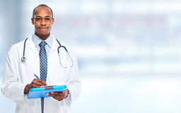 African-American black doctor man. African-American black doctor man over blue background royalty free stock photo