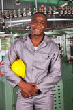 African american blue collar. Industrial worker in factory royalty free stock image