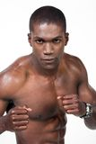 African american boxer. Muscular African American athlete portrait in boxing position Stock Photos