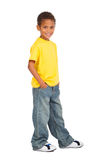 African american boy. Portrait of a cute preteen african american boy in jeans and t-shirt on white background Royalty Free Stock Photography