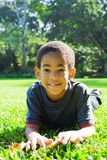 African american boy. Happy african american boy portrait on green grass Royalty Free Stock Photography