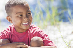 African American Boy Child Outside. A young African American boy child outside in the summer sunshine Royalty Free Stock Photography