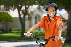 African American Boy Child Riding Bike. A young African American boy child riding bicycle or bike in the summer Stock Photos