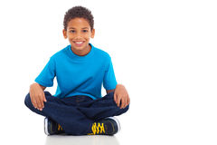 African american boy. Cute african american boy sitting on white background Royalty Free Stock Images