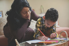 African American boy drawing at home. stock photo