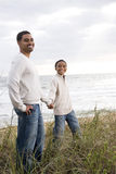 African-American boy with father on sand dunes Royalty Free Stock Photography
