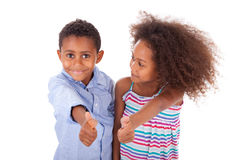 African American boy and girl making thumbs up gesture - Black p royalty free stock photography