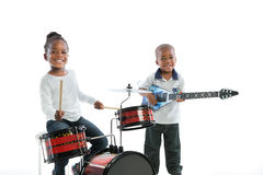 African American Boy  and Girl Playing Drum Set Isolated Stock Image