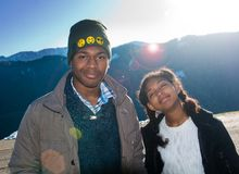 African American boy and girl on vacation in the mountains. African American boy and girl smile in the sun on vacation in the mountains Stock Photography