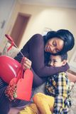 African American woman wit her son. African American boy giving a bouquet of flowers to his mother Stock Image