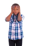 African American boy hiding ears  - Black people. African American boy hiding ears, isolated on white background  - Black people Royalty Free Stock Photos