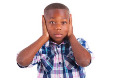 African American boy hiding ears  - Black people Stock Photos