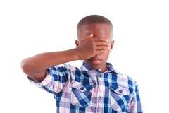 African American boy hiding eyes  - Black people. African American boy hiding eyes, isolated on white background  - Black people Royalty Free Stock Photos