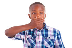African American boy hiding mouth  - Black people Stock Images