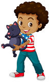African American boy and his pet cat Stock Photography