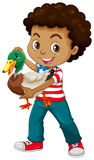African american boy holding a duck Stock Image