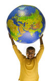 African American boy holding a globe. African American boy struggles as he holds an inflatable globe on a white background Stock Photo