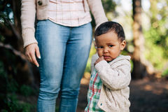 African American Boy holding his mother hand royalty free stock photography