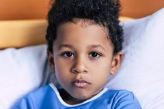 African american boy lying in bed Royalty Free Stock Photography