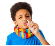 African American boy with nasal spray Stock Photos