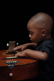 African american boy play guitar royalty free stock photography
