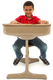 African American Boy Sitting In A Desk stock photos